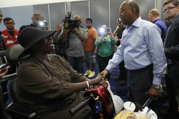 Mayor Sylvester Turner shakes hands with Marva Hill, who was evacuated from the Fifth Ward, at the George R. Brown Convention Center, where the Red Cross had set up a shelter for those displaced by Tropical Storm Harvey, Friday, Sept. 1, 2017, in Houston.   ( Karen Warren / Houston Chronicle )