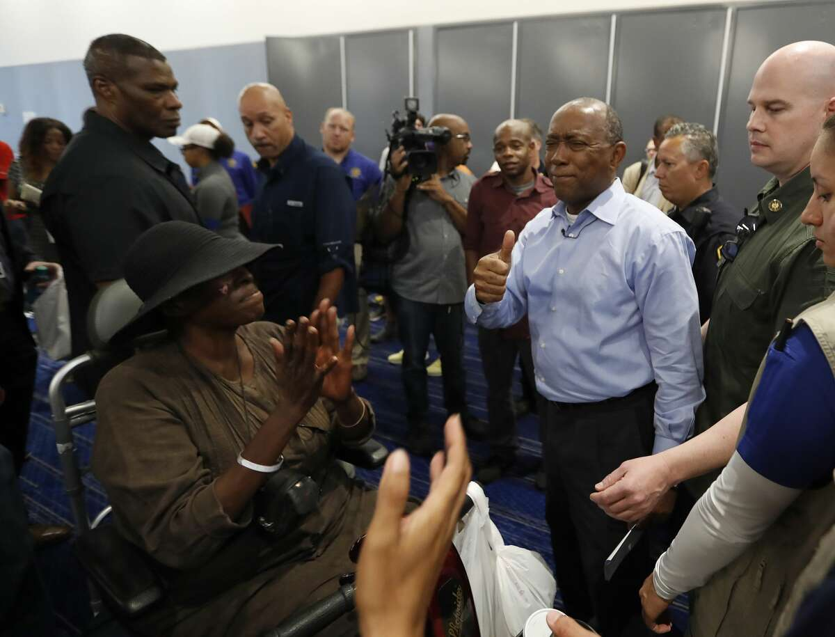 Mayor Sylvester Turner smiles as Marva Hill, who was evacuated from the Fifth Ward, and others started clapping for him at the George R. Brown Convention Center, where the Red Cross had set up a shelter for those displaced by Tropical Storm Harvey, Friday, Sept. 1, 2017, in Houston. ( Karen Warren / Houston Chronicle )