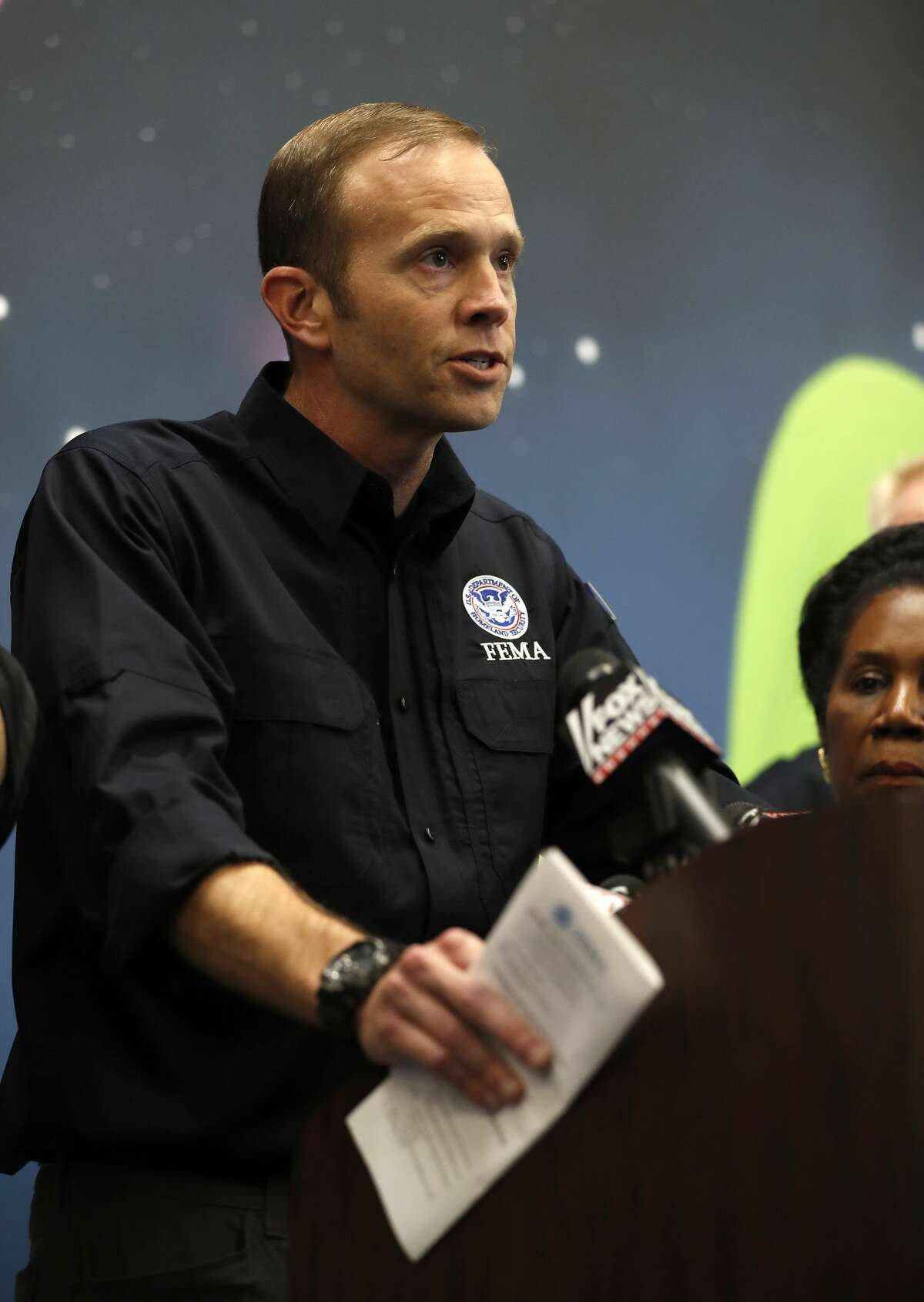 Brock Long, FEMA administrator, speaks at the George R. Brown Convention Center, where the Red Cross had set up a shelter,on Friday, Sept. 1, 2017, in Houston.