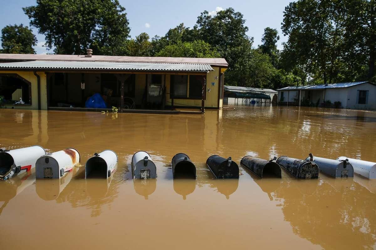 Mailboxes sit underwater as a flooded Brazos River flows down Newlin Drive after Hurricane Harvey.