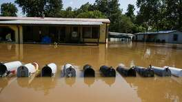 Mailboxes sit underwater as a flooded Brazos River flows down Newlin Drive after Tropical Storm Harvey.