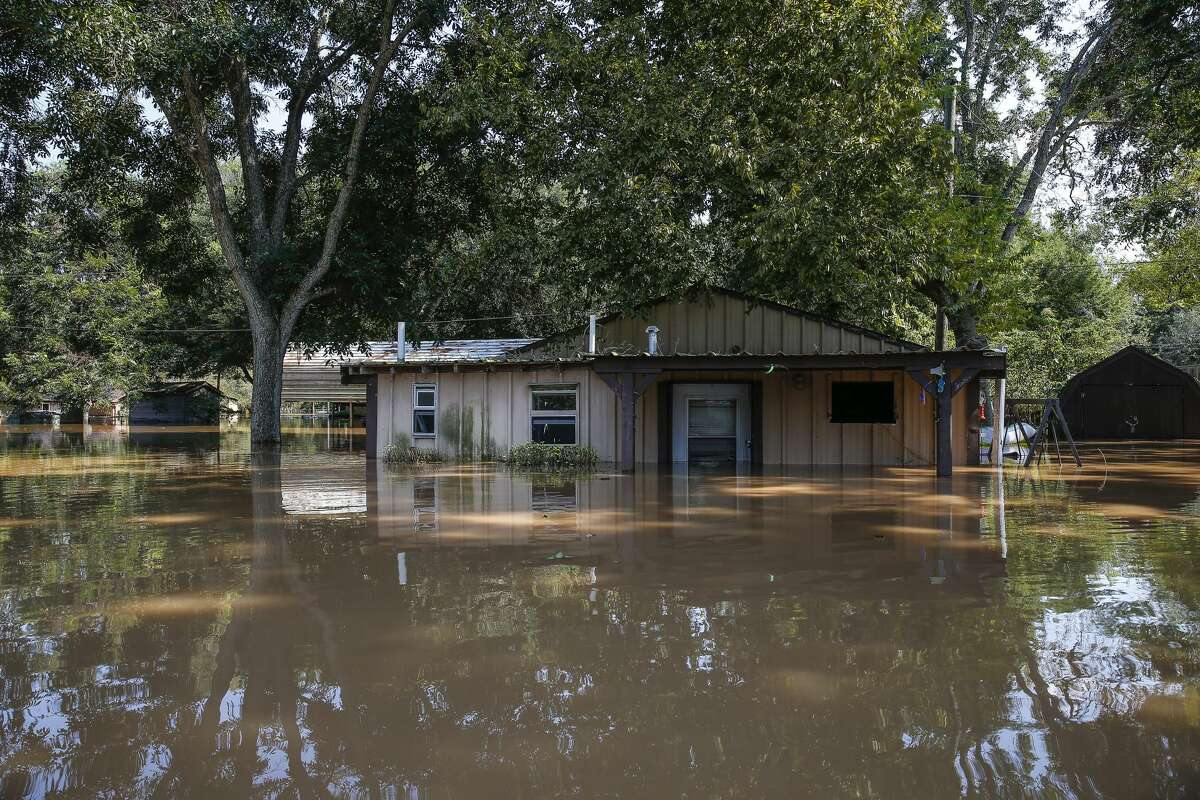 A flooded hose sits in floodwaters from the Brazos River after Tropical Storm Harvey Friday, Sept. 1, 2017 in Richmond.