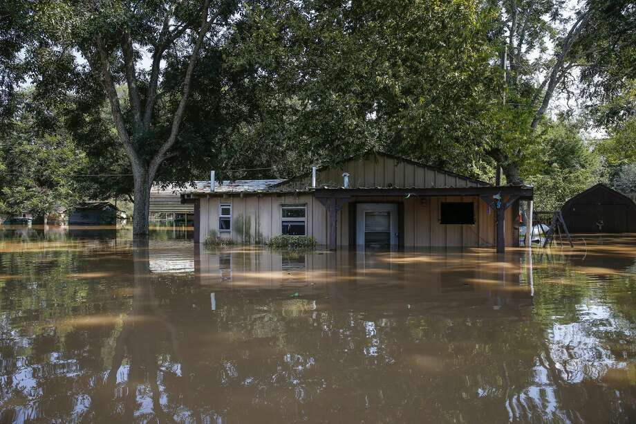 A flooded hose sits in floodwaters from the Brazos River after Tropical Storm Harvey Friday, Sept. 1, 2017 in Richmond. Photo: Michael Ciaglo