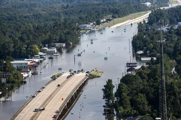 Highway 96 sits submerged by floodwaters from Tropical Storm Harvey on Friday, Sept. 1, 2017, in Lumberton, Texas. ( Brett Coomer / Houston Chronicle )