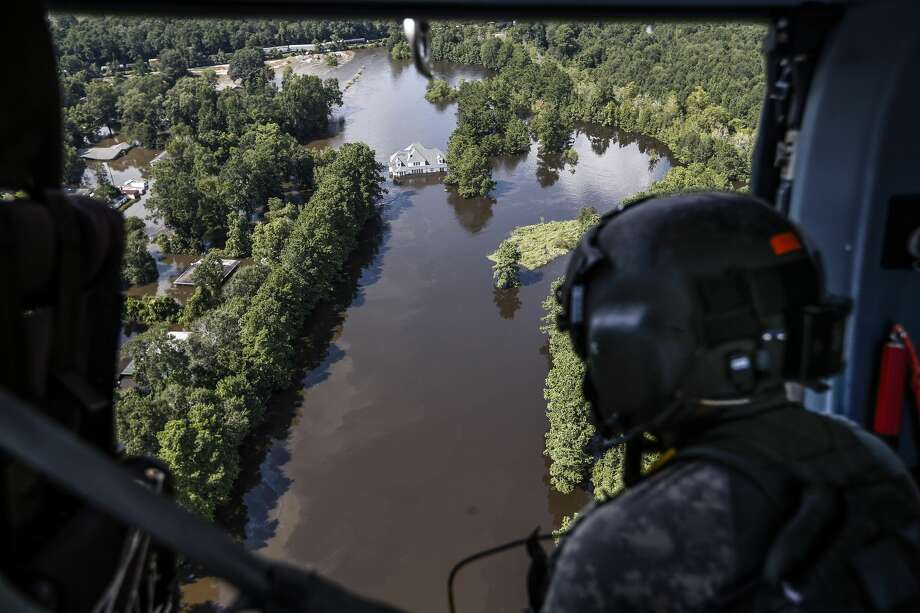 Sgt. Destry Riggs scans flooded areas during a search and rescue operation run by the 36th Combat Aviation Brigade of the Texas Army national Guard over areas hit by Tropical Storm Harvey on Friday, Sept. 1, 2017, north of Beaumont, Texas. ( Brett Coomer / Houston Chronicle ) Photo: Brett Coomer/Houston Chronicle