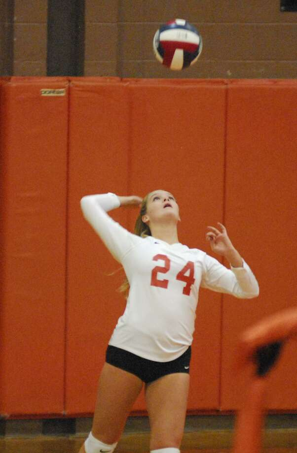 Ridgefield'sMackenzie Wanicka hits a serve during a game against Brien McMahon on Monday, October 2, 2017 Photo: Ryan Lacey / Hearst Connecticut Media