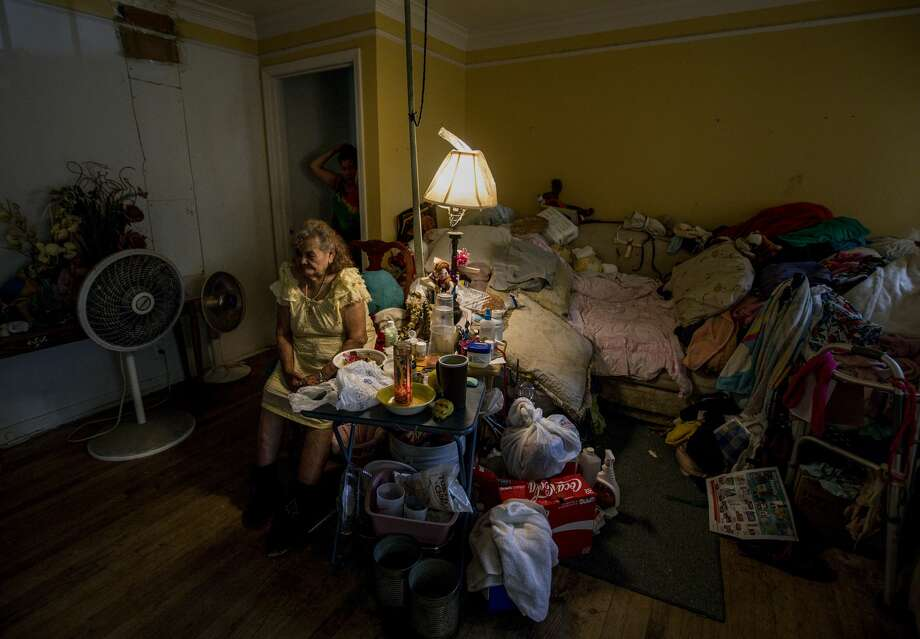 Pabla Cruz, 88, front, sits in the living room of her house with her daughter, Aurelia Estrada, rear, during a food delivery by Meals on Wheels, the first since Tropical Storm Harvey, Friday, Sept. 1, 2017, in Houston. Cruz and her daughter rode out Tropical Storm Harvey by eating tortillas and water. ( Jon Shapley  / Houston Chronicle ) Photo: Jon Shapley/Houston Chronicle