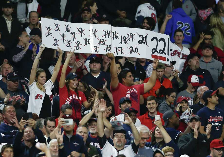 CLEVELAND, OH - SEPTEMBER 14: Cleveland Indians fans cheer after the Indians defeated the Royals 3-2 in ten innings at Progressive Field on September 14, 2017 in Cleveland, Ohio. The Indians defeated the Royals 3-2 for their 22nd win in a row, an MLB record. (Photo by Ron Schwane/Getty Images) ORG XMIT: 700012460 Photo: Ron Schwane / 2017 Getty Images