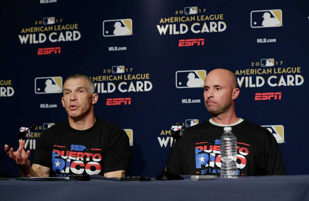 New York Yankees manager Joe Girardi, left, speaks about recovery efforts in Puerto Rico at a news conference with third base coach Joe Espada, right, before their upcoming American League wildcard baseball game against the Minnesota Twins, Monday, Oct. 2, 2017, in New York. (AP Photo/Frank Franklin II) ORG XMIT: NYY129
