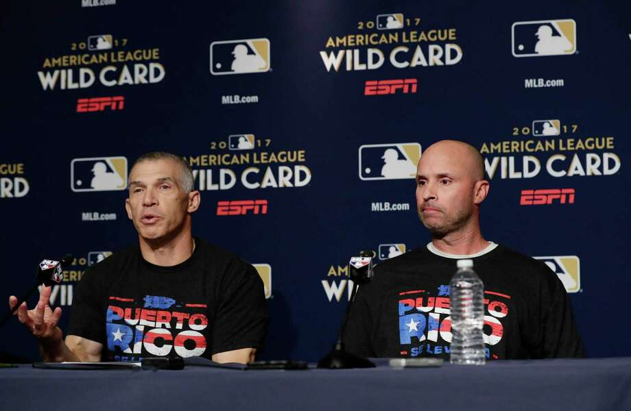 New York Yankees manager Joe Girardi, left, speaks about recovery efforts in Puerto Rico at a news conference with third base coach Joe Espada, right, before their upcoming American League wildcard baseball game against the Minnesota Twins, Monday, Oct. 2, 2017, in New York. (AP Photo/Frank Franklin II) ORG XMIT: NYY129 Photo: Frank Franklin II / Copyright 2017 The Associated Press. All rights reserved.