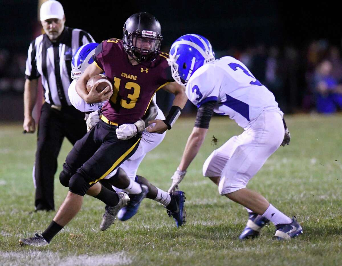 Colonie's Eddie Soto (13) runs the ball against Shaker during a Section II Class AA high school football game in Colonie, N.Y., Thursday, Sept. 28, 2017. (Hans Pennink / Special to the Times Union) ORG XMIT: HP122