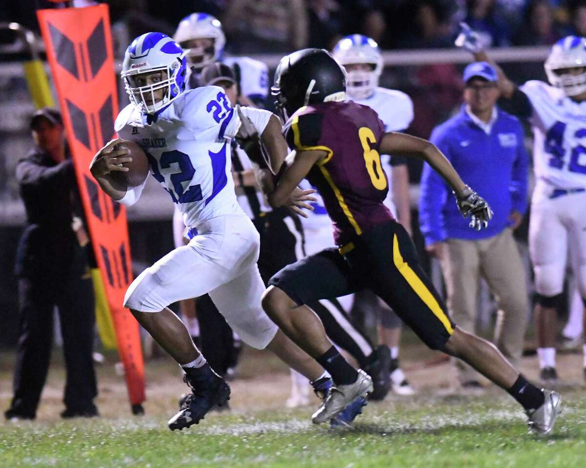 Shaker's Ravion Burt (22) runs the ball past Colonie's Anthony Libertucci (6) during a Section II Class AA high school football game in Colonie, N.Y., Thursday, Sept. 28, 2017. (Hans Pennink / Special to the Times Union) ORG XMIT: HP116