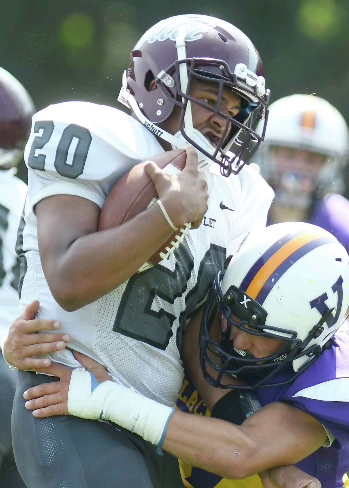 Watervliet's Kareem Duncan (20) runs the ball against Voorheesville during a Section II Class C high school football game in Voorheesville, N.Y., Saturday, Sept. 16, 2017. (Hans Pennink / Special to the Times Union) ORG XMIT: HP115