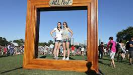 Mackenzie Clayton (left) and her sister Cara Clayton pose for photos during the 2014 Austin City Limits Music Festival at Zilker Park.