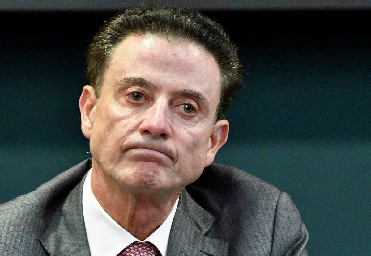 FILE - In this Oct. 20, 2016, file photo, Louisville coach Rick Pitino reacts to a question during an NCAA college basketball press conference in Louisville, Ky. Louisville announced Wednesday, Sept. 27, 2017, that they have placed basketball coach Rick Pitino and athletic director Tom Jurich on administrative leave amid an FBI probe. (AP Photo/Timothy D. Easley, File) ORG XMIT: NY157