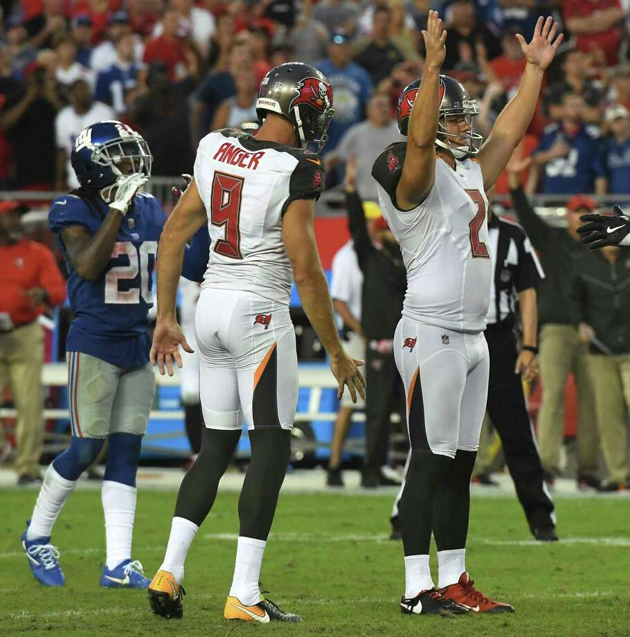 Tampa Bay Buccaneers kicker Nick Folk (2) celebrates his game-winining field goal as time expires with punter Bryan Anger (9) during an NFL football game Sunday, Oct. 1, 2017, in Tampa, Fla. (AP Photo/Jason Behnken) ORG XMIT: TPS28 Photo: Jason Behnken / FR171457 AP