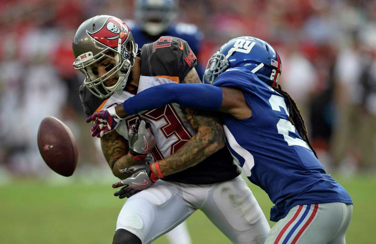 Tampa Bay Buccaneers wide receiver Mike Evans (13) has a pass knocked away by New York Giants cornerback Janoris Jenkins (20) during the fourth quarter of an NFL football game Sunday, Oct. 1, 2017, in Tampa, Fla. (AP Photo/Jason Behnken) ORG XMIT: TPS25