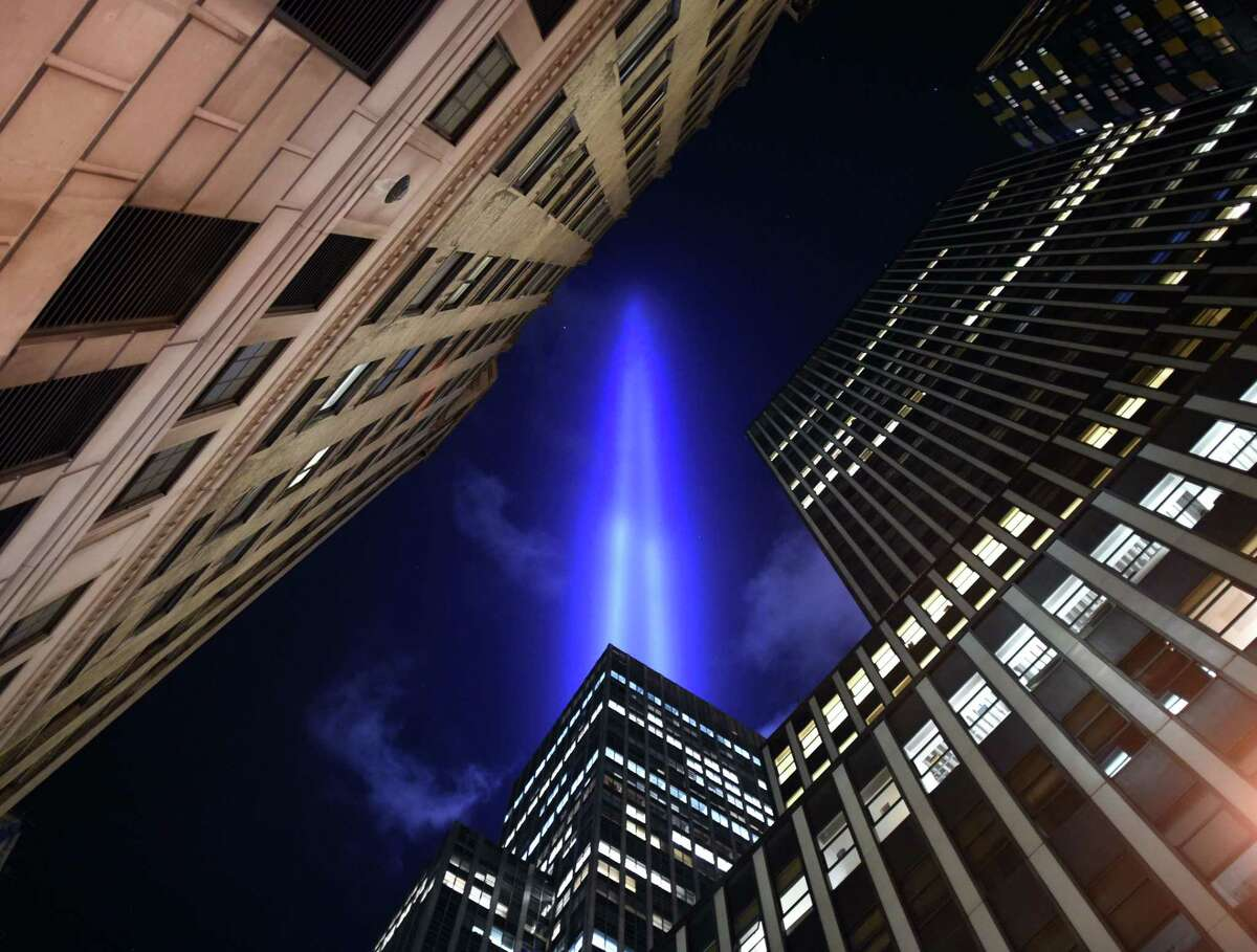 TOPSHOTS The Tribute in Light illuminates the sky down in the Wall Street area of lower Manhattan in New York on September 10, 2014 on the night before the 13th anniversary of the September 11, 2001 attacks. The tribute, an art installation of the Municipal Art Society, consists of 88 searchlights placed next to the site of the World Trade Center creating two vertical columns of light in remembrance of the 2001 attacks. AFP PHOTO / TIMOTHY A. CLARYTIMOTHY A. CLARY/AFP/Getty Images