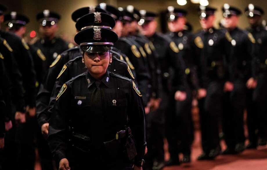 Graduating Houston Police Officer Maria Flores marches in front of her fellow cadets during the graduation ceremony of HPD Cadet Class 232 at Greater Grace Outreach Church on Monday, Oct. 2, 2017, in Houston. There were 59 new officers to be sworn in during the ceremony. Photo: Brett Coomer, Houston Chronicle / © 2017 Houston Chronicle