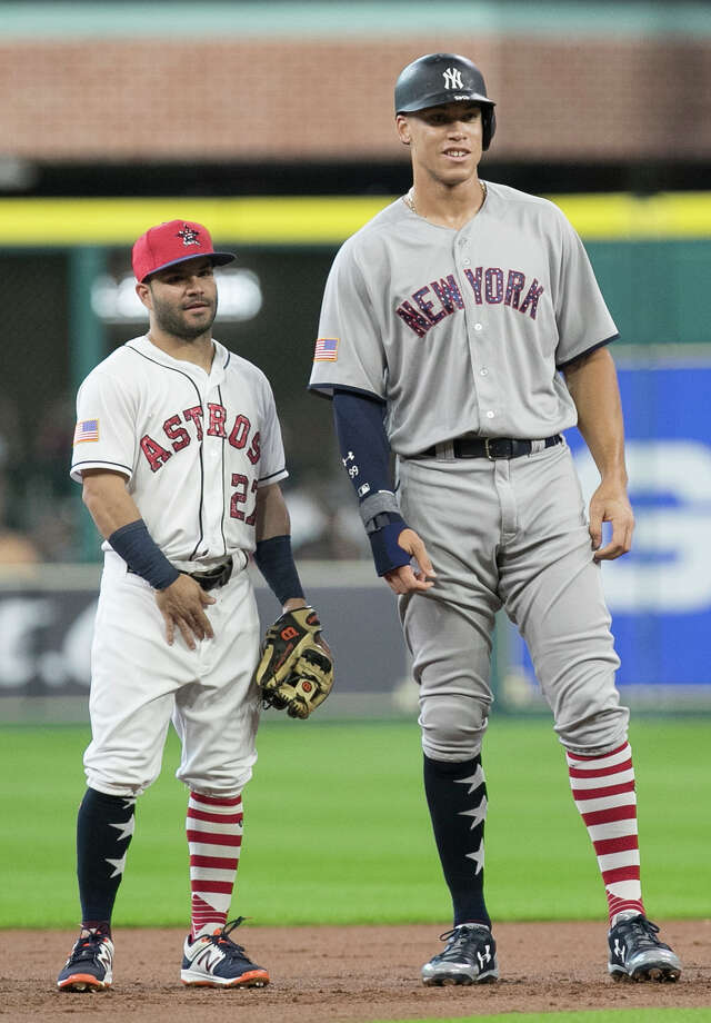 Astros second baseman Jose Altuve and Yankees slugger Aaron Judge were able to size each other up after New York's slugging rookie doubled in a July game at Minute Maid Park. Photo: Yi-Chin Lee, Staff / © 2017  Houston Chronicle