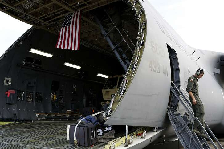 Senior Airman Antonio Farias, a crew chief out of Joint Base San Antonio- Lackland, works to unload supplies from a C-5M at Jose Aponte de la Torre Airport in Ceiba, Puerto Rico.