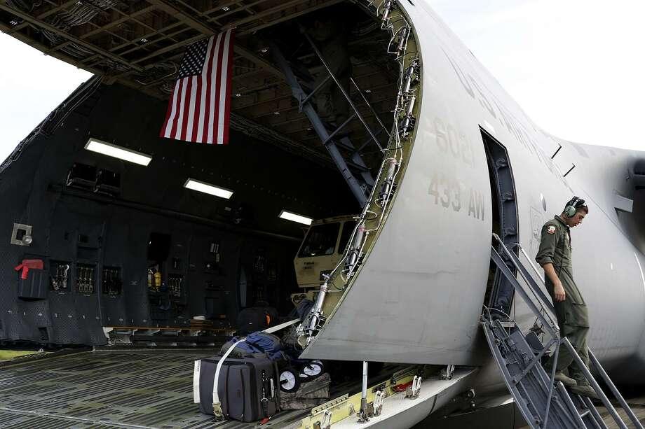 Senior Airman Antonio Farias, a crew chief out of Joint Base San Antonio- Lackland, works to unload supplies from a C-5M at Jose Aponte de la Torre Airport in Ceiba, Puerto Rico. Photo: Lisa Krantz /San Antonio Express-News / SAN ANTONIO EXPRESS-NEWS