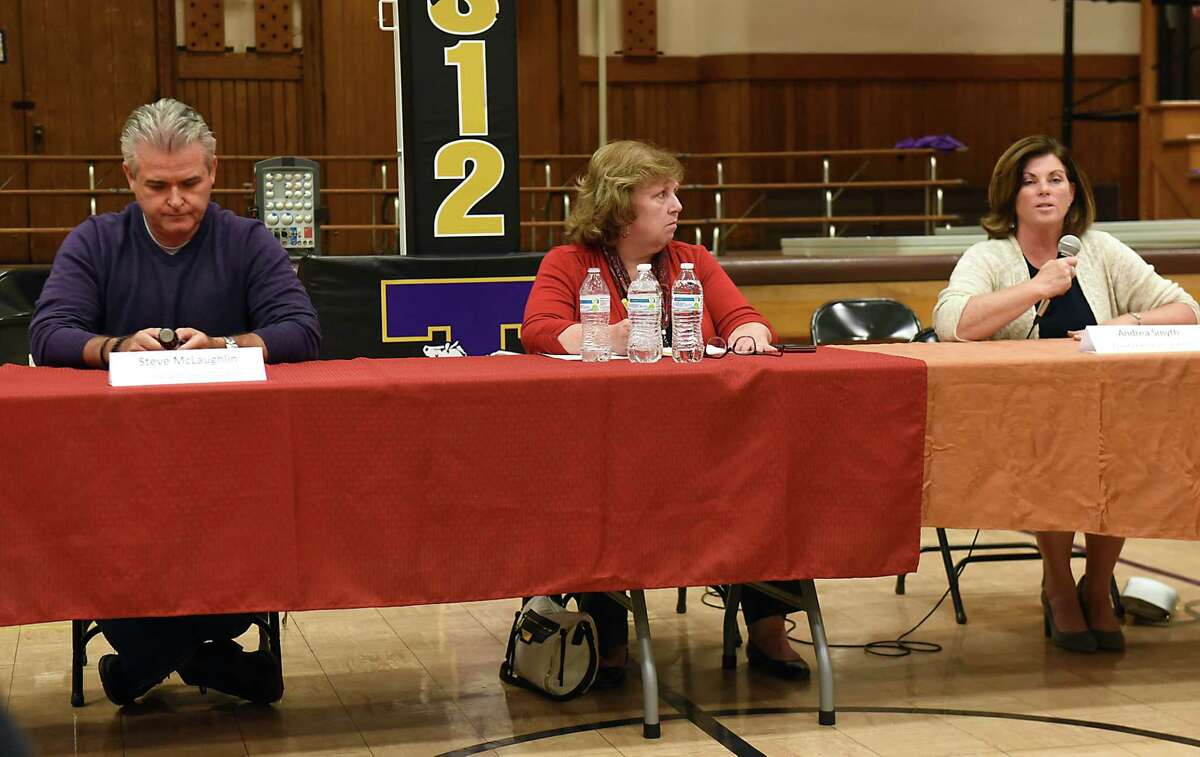 Rensselaer Co. Executive candidates Assemblyman Steven McLaughlin, the Republican candidate, and Democratic candidate Andrea Smyth meet at Troy candidates night sponsored by Troy Neighborhood Action Council at School 12 on Monday, Oct. 2, 2017 in Troy, N.Y. Lisa Lewis, center, was the moderator. (Lori Van Buren / Times Union)
