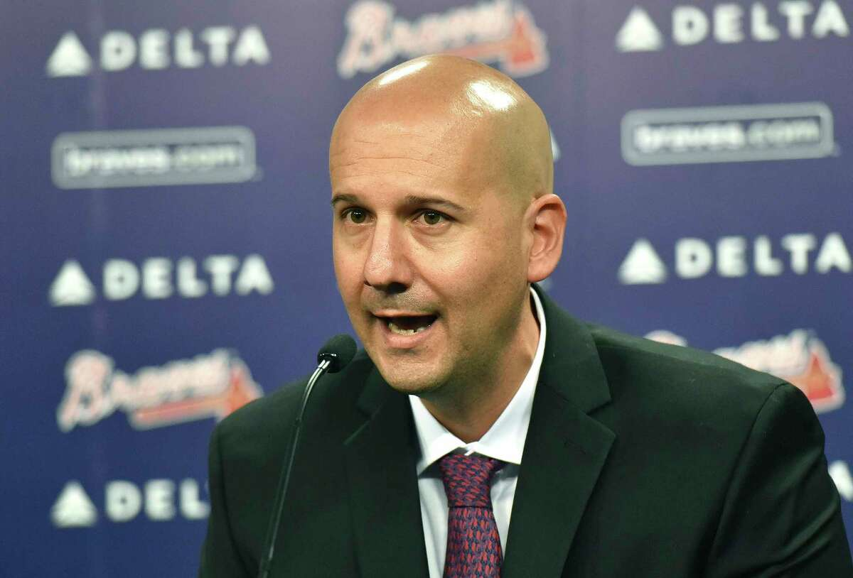 FILe - In this Oct. 1, 2015, file photo, Atlanta Braves general manager John Coppolella speaks during a baseball news conference at Turner Field in Atlanta. Coppolella has resigned from his position, the Braves announced on Monday afternoon, Oct. 2, 2017 (Hyosub Shin/Atlanta Journal-Constitution via AP, File) ORG XMIT: GAATJ501