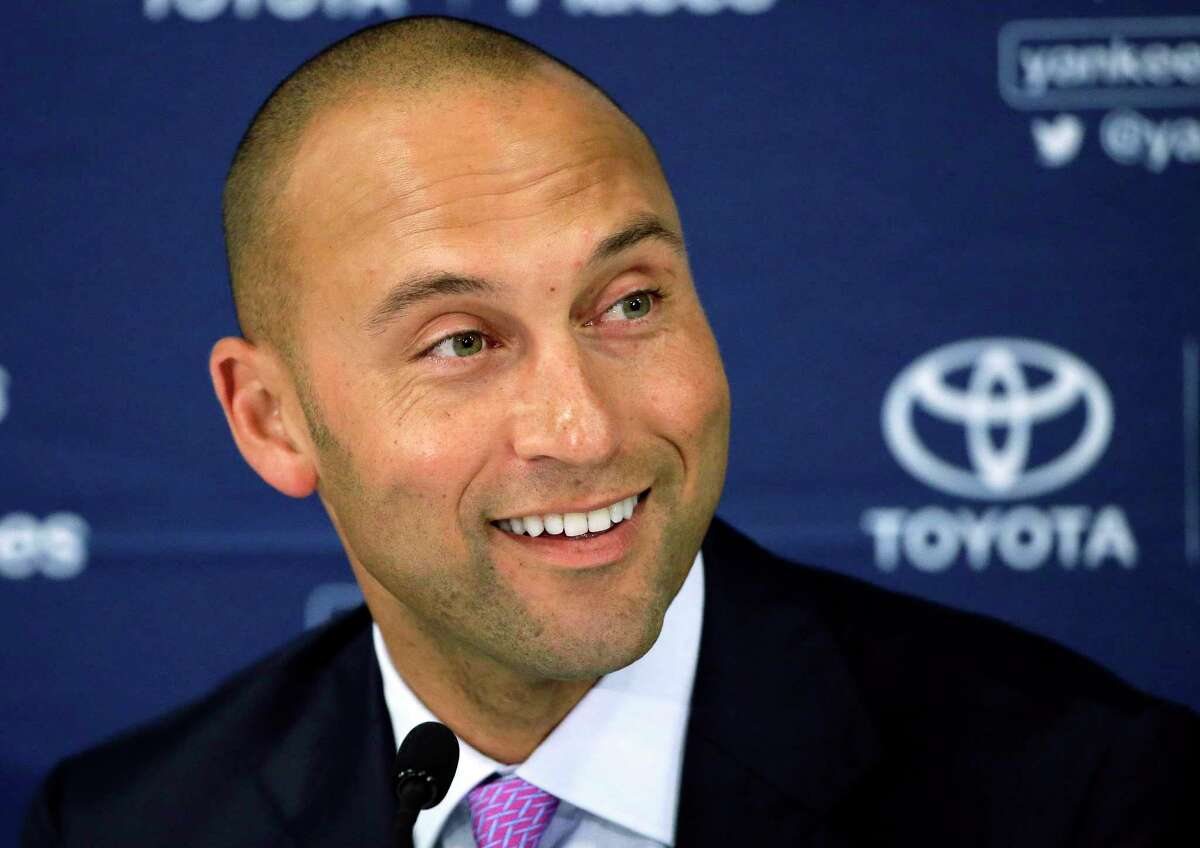 FILE - In this Sept. 28, 2014, file photo, New York Yankees' Derek Jeter speaks to the media after the last baseball game of his career, against the Boston Red Sox, at Fenway Park in Boston. Two people familiar with the vote say major league owners have approved the sale of the Miami Marlins by Jeffrey Loria to an investment group led by Bruce Sherman and Derek Jeter. The people confirmed the vote to The Associated Press on condition of anonymity Wednesday, Sept. 17, 2017, because the approval had not been announced. One of the people said the vote was unanimous, with 75 percent approval needed. (AP Photo/Steven Senne, File) ORG XMIT: NY192