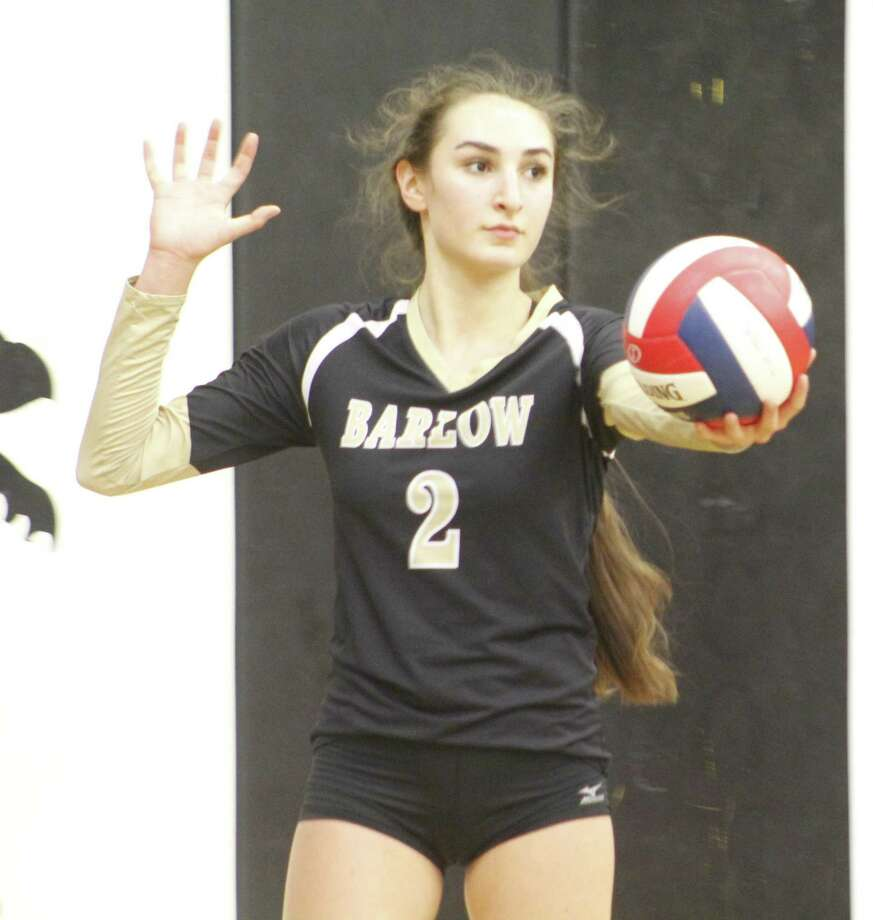 Joel Barlow's Kiara Robichaud lines up a serve during the volleyball match against Pomperaug at Joel Barlow High School in Redding Oct. 2, 2017. Photo: Richard Gregory / Richard Gregory