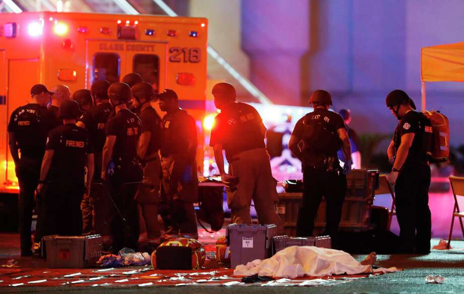 A body is covered with a sheet after the mass shooting on the Las Vegas Strip. Photo: Steve Marcus, MBO / LV Sun