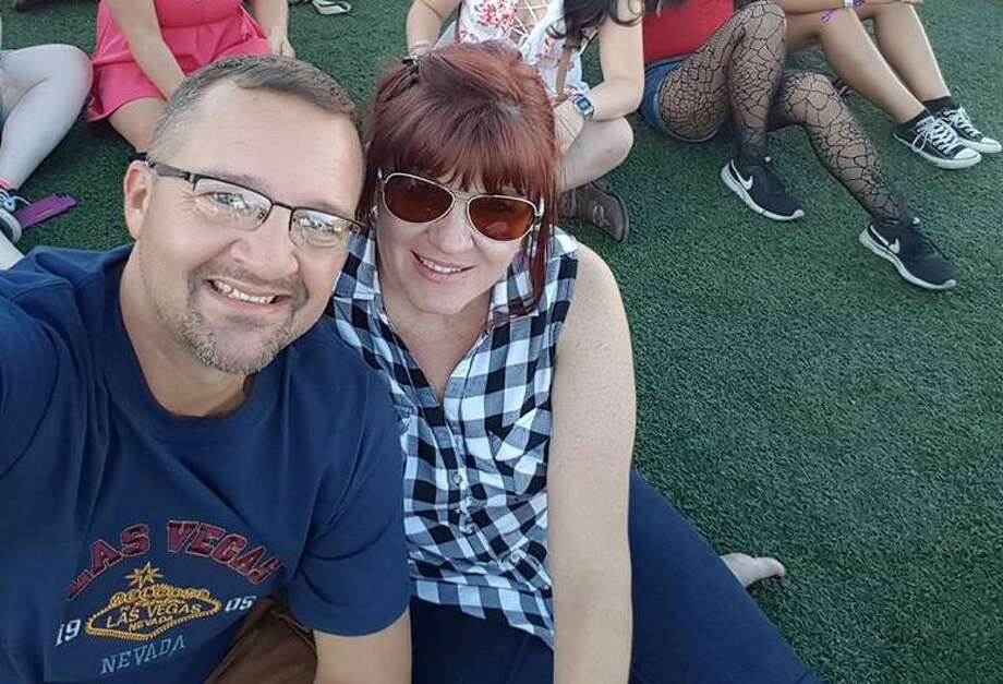 Mark and Sherrell Bethune are shown at the Route 91 Harvest Festival in Las Vegas, where the Galveston County native was celebrating his 50th birthday with his wife. This photo was taken hours before gunfire broke out. Photo: Mark Bethune / Courtesy