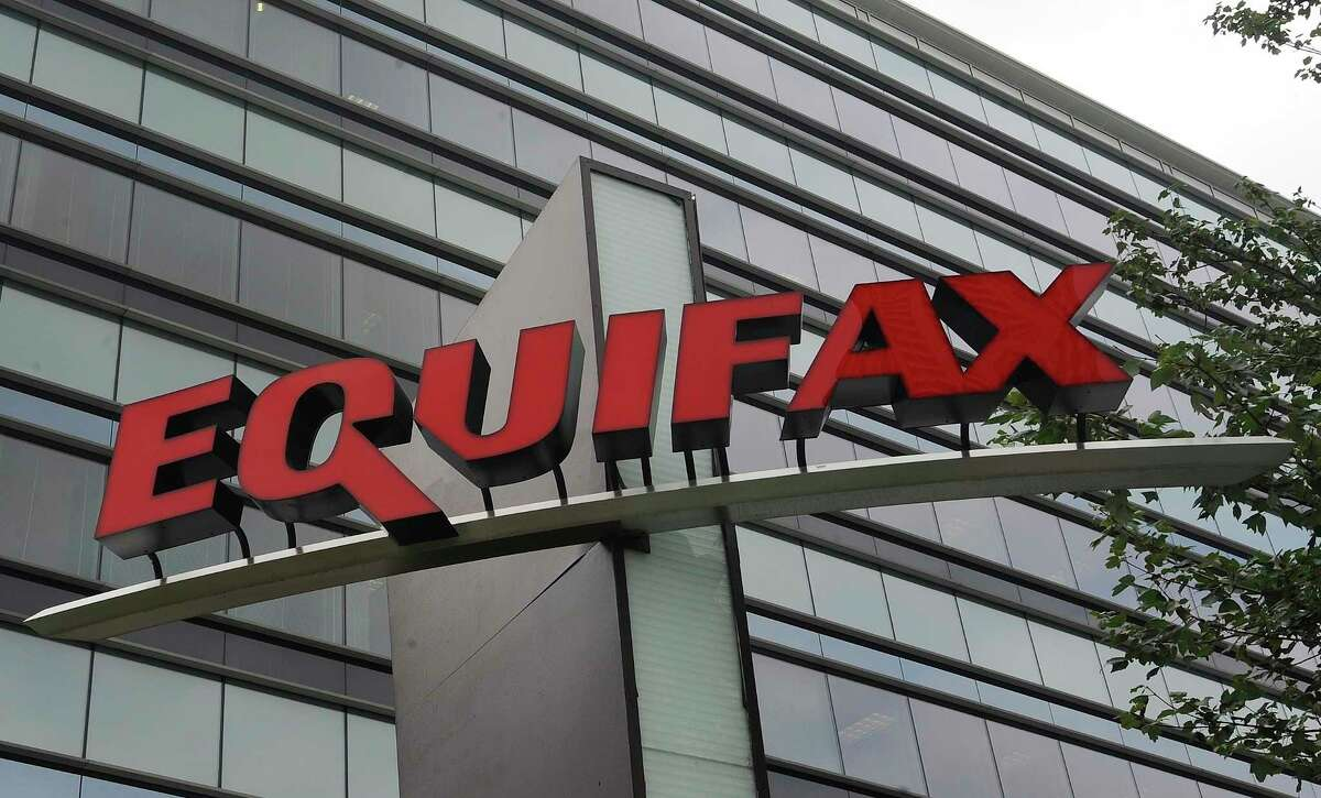 FILE - This July 21, 2012, file photo shows signage at the corporate headquarters of Equifax Inc. in Atlanta. Credit report company Equifax said Monday, Oct. 2, 2017, that an additional 2.5 million Americans may have been affected by the massive security breach of its systems, bringing the total to 145.5 million people who had their personal information accessed or stolen. (AP Photo/Mike Stewart, File) ORG XMIT: NYJK301