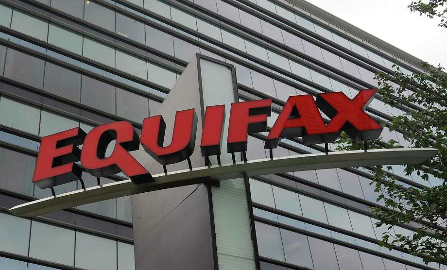 FILE - This July 21, 2012, file photo shows signage at the corporate headquarters of Equifax Inc. in Atlanta. Credit report company Equifax said Monday, Oct. 2, 2017, that an additional 2.5 million Americans may have been affected by the massive security breach of its systems, bringing the total to 145.5 million people who had their personal information accessed or stolen. (AP Photo/Mike Stewart, File) ORG XMIT: NYJK301 Photo: Mike Stewart / Copyright 2017 The Associated Press. All rights reserved.