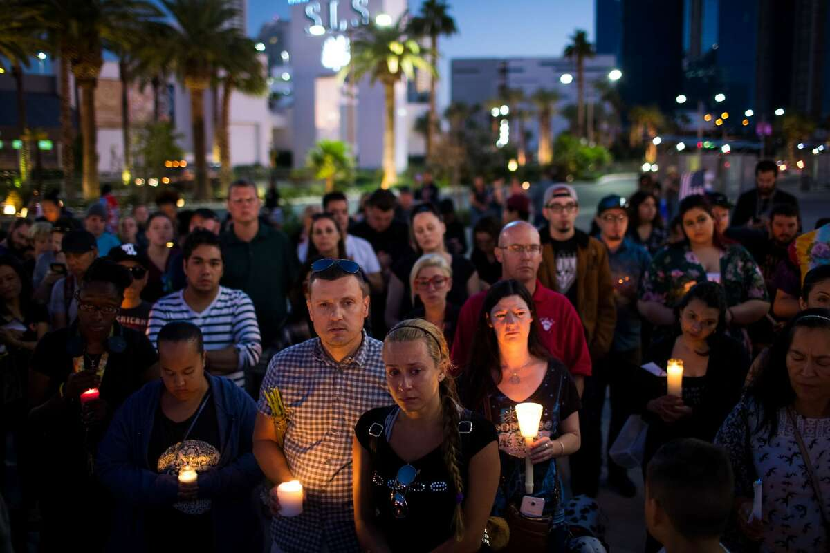 Mourners attend a candlelight vigil at the corner of Sahara Avenue and Las Vegas Boulevard for the victims of Sunday night's mass shooting, October 2, 2017 in Las Vegas, Nevada. Late Sunday night, a lone gunman killed more than 50 people and injured more than 500 people after he opened fire on a large crowd at the Route 91 Harvest Festival, a three-day country music festival. The massacre is one of the deadliest mass shooting events in U.S. history. (Photo by Drew Angerer/Getty Images)