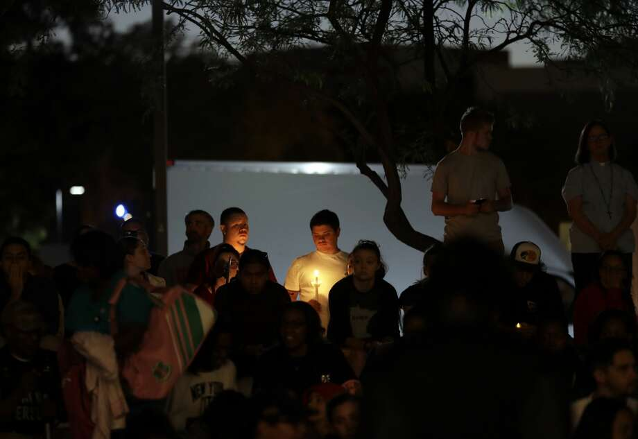 Students from University of Nevada Las Vegas hold a vigil Monday, Oct. 2, 2017, in Las Vegas. A gunman on the 32nd floor of the Mandalay Bay casino hotel rained automatic weapons fire down on the crowd of over 22,000 at an outdoor country music festival Sunday. (AP Photo/Gregory Bull) Photo: Gregory Bull/AP