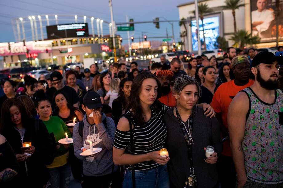 Mourners attend a candlelight vigil at the corner of Sahara Avenue and Las Vegas Boulevard for the victims of Sunday night's mass shooting, October 2, 2017 in Las Vegas, Nevada. Late Sunday night, a lone gunman killed more than 50 people and injured more than 500 people after he opened fire on a large crowd at the Route 91 Harvest Festival, a three-day country music festival. The massacre is one of the deadliest mass shooting events in U.S. history. (Photo by Drew Angerer/Getty Images) Photo: Drew Angerer/Getty Images