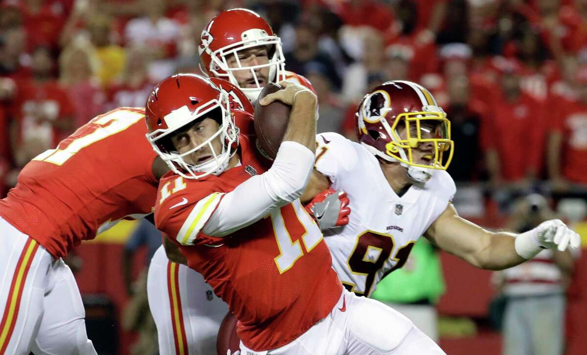 Kansas City Chiefs quarterback Alex Smith (11) tries to avoid Washington Redskins linebacker Ryan Kerrigan (91) during the first half of an NFL football game in Kansas City, Mo., Monday, Oct. 2, 2017. (AP Photo/Charlie Riedel) ORG XMIT: MONH111