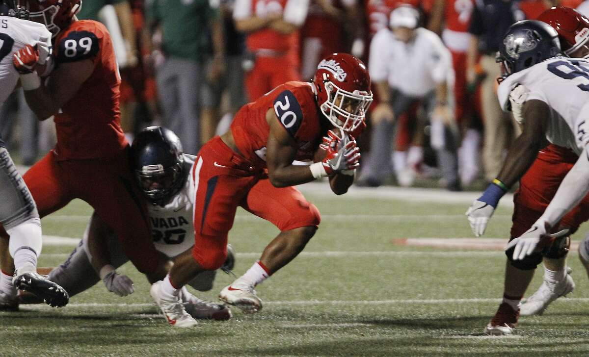 Fresno State's Ronnie Rivers heads through the line against Nevada in the first half of an NCAA college football game in Fresno, Calif., Saturday, Sept. 30, 2017. (AP Photo/Gary Kazanjian)