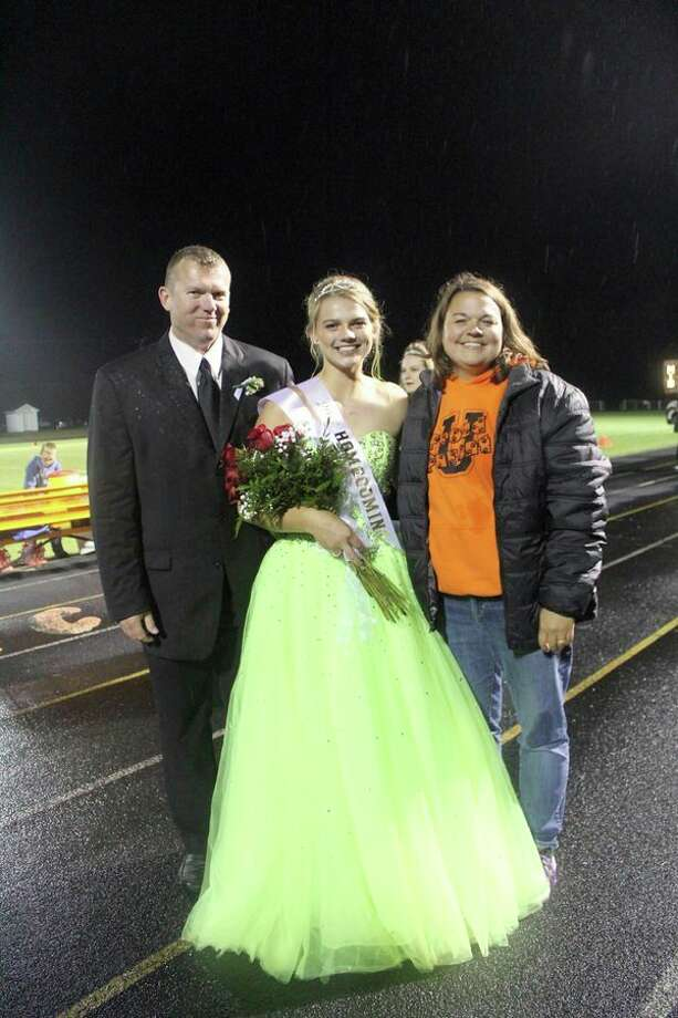 Kara Peruski, a senior at Ubly High School, was crowned this year's homecoming queen during Friday night's football game. She is pictured here with her parents, Skatch and Tammy Peruski. (Submitted Photo)