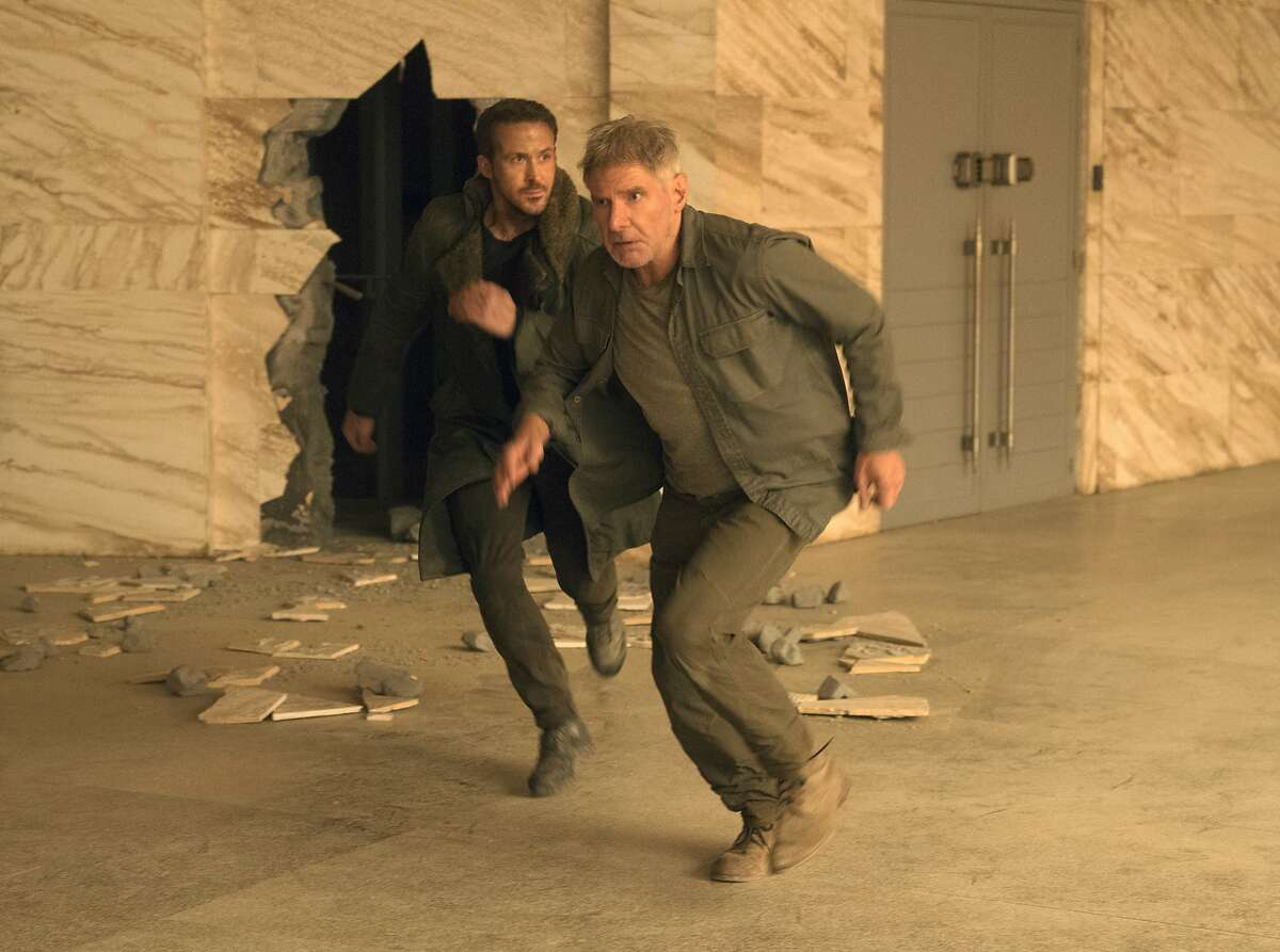 This image released by Warner Bros. Pictures shows Ryan Gosling, left, and Harrison Ford in a scene from