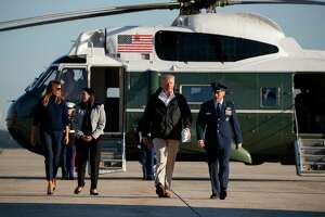 President Donald Trump and first lady Melania Trump walk to board Air Force One for a trip to Puerto Rico to survey hurricane damage and recovery efforts, Tuesday, Oct. 3, 2017, in Andrews Air Force Base, Md.