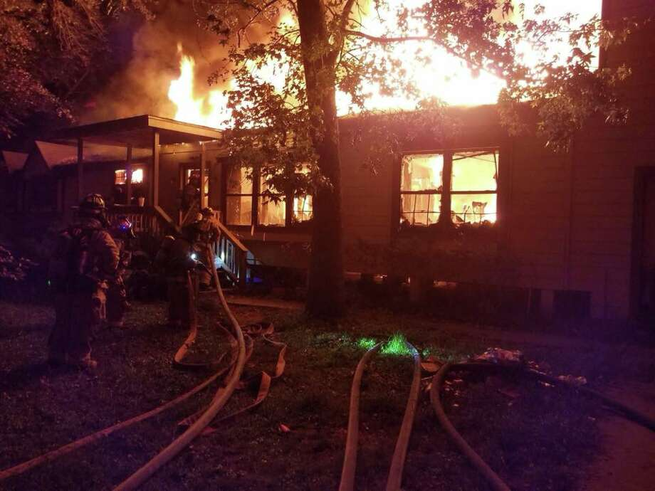 Firefighters with the East Montgomery County, Porter and Caney Creek fire departments battle an early-morning blaze that engulfed a single family home in New Caney on Tuesday, Oct. 3, 2017. Photo: East Montgomery County Fire Department