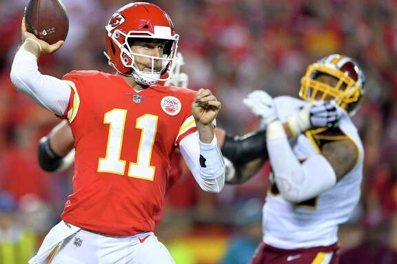 Kansas City Chiefs quarterback Alex Smith (11) delivered a pass in the fourth quarter during the Kansas City Chiefs and Washington football game in Arrowhead Stadium on Monday, Oct. 2, 2017, in Kansas City, Mo. The Chifs won, 29-20.