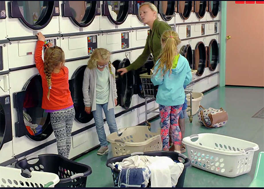 """Daughter-in-law Kacie Putman, is pictured with three Putman children at the Bay Wash Coin Laundry in Caseville in a clip form Monday night's episode of """"Meet the Putmans"""" on TLC. Photo: Brenda Battel,  Tribune Staff Writer"""