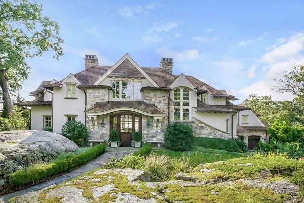 This 8,733-square-foot stone and stucco house at 8 North Road is in the Tokeneke section of town.