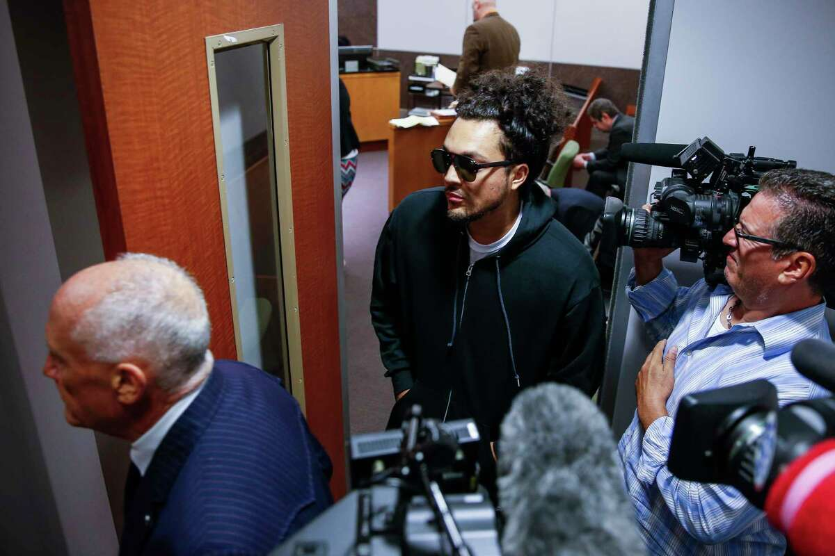 Michael Anthony Cuellar, 29, turns himself in with his lawyer, Paul Looney, left, at the Harris County Juvenile Courthouse after he was identified as one of the shooters in a now-viral Snapchat video Tuesday, Oct. 3, 2017 in Houston. The video allegedly showed Cuellar and a passenger, Sierra Tarbutton, shooting from a car near the 15800 block of Memorial Drive.