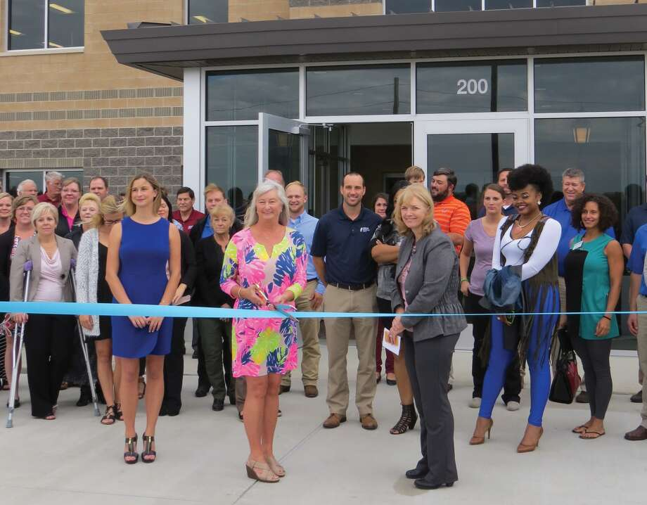 Donco owner and president Cindy Fowler cuts the ribbon at the new facility on Lakefront Parkway. Photo: Carol Arnett
