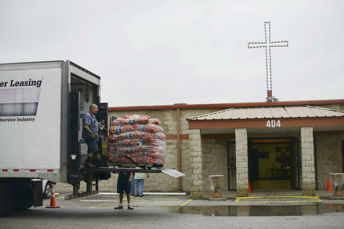 Sacks of onions are delivered by the San Antonio Food Bank to Last Chance Ministries in the Westside on Friday, Sept. 29, 2017. Pastor Jimmy Robles of Last Chance Ministries said that he is happy to receive of the abundance of donations due to hurricanes.