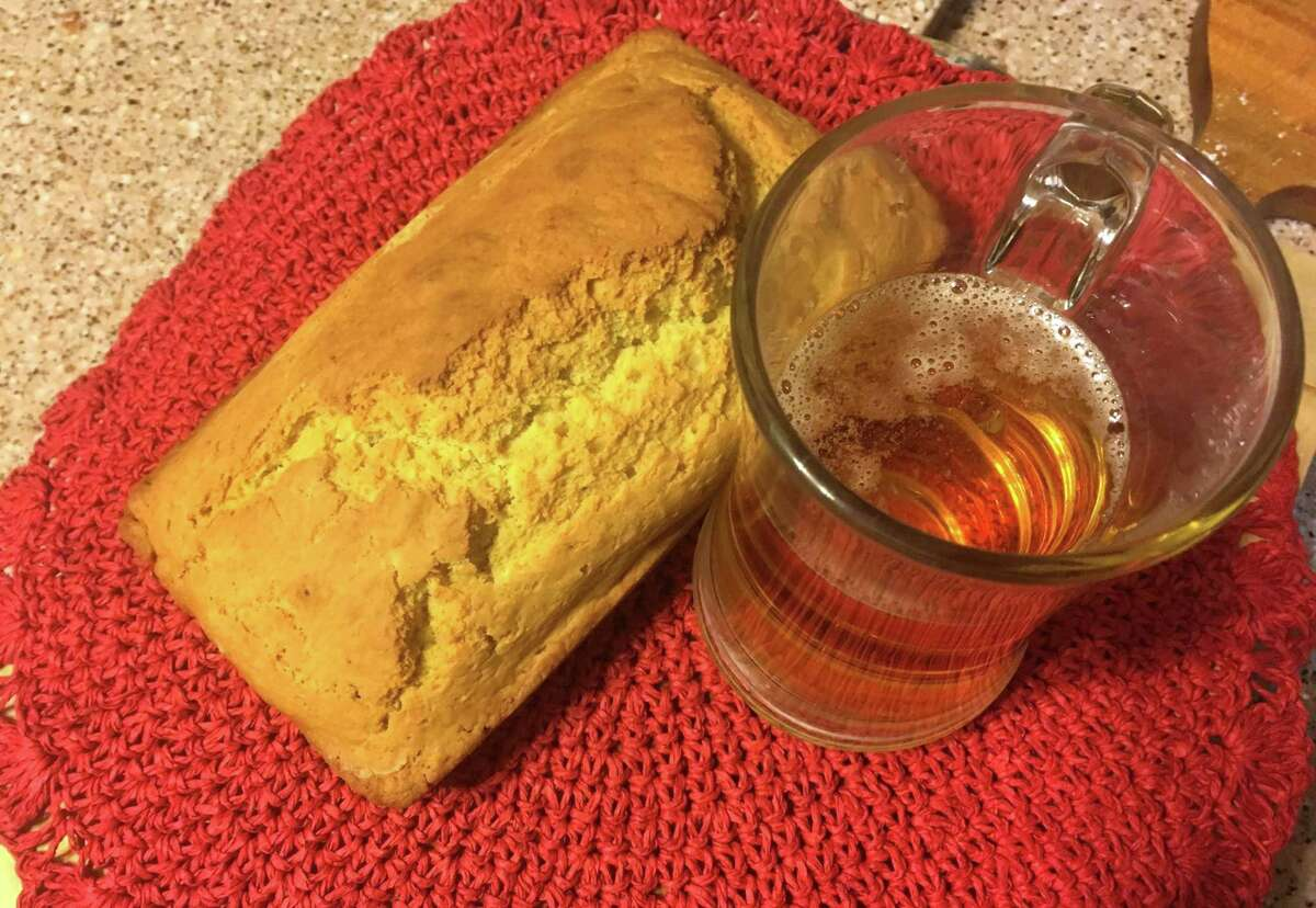 Beer bread is as simple as mixing a 12-ounce lager beer with flour, baking soda, baking powder, salt, sugar and a little olive oil into an 8-inch loaf pan.
